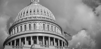 United States Capitol with dark clouds around it in black and white