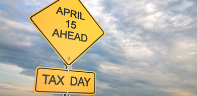 yellow sign tax day april 15 ahead