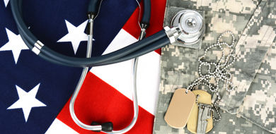 red white and blue American flag with physician's stethoscope and military tags and uniform