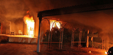 Fire raging at site of Benghazi attack
