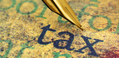 Gold pen with navy blue word tax printed on paper