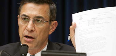 Senator Darrell Issa holding up paper in OGR Committee